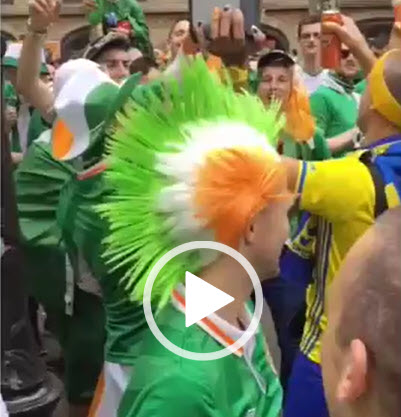 Irish fans dance with Swedish fans